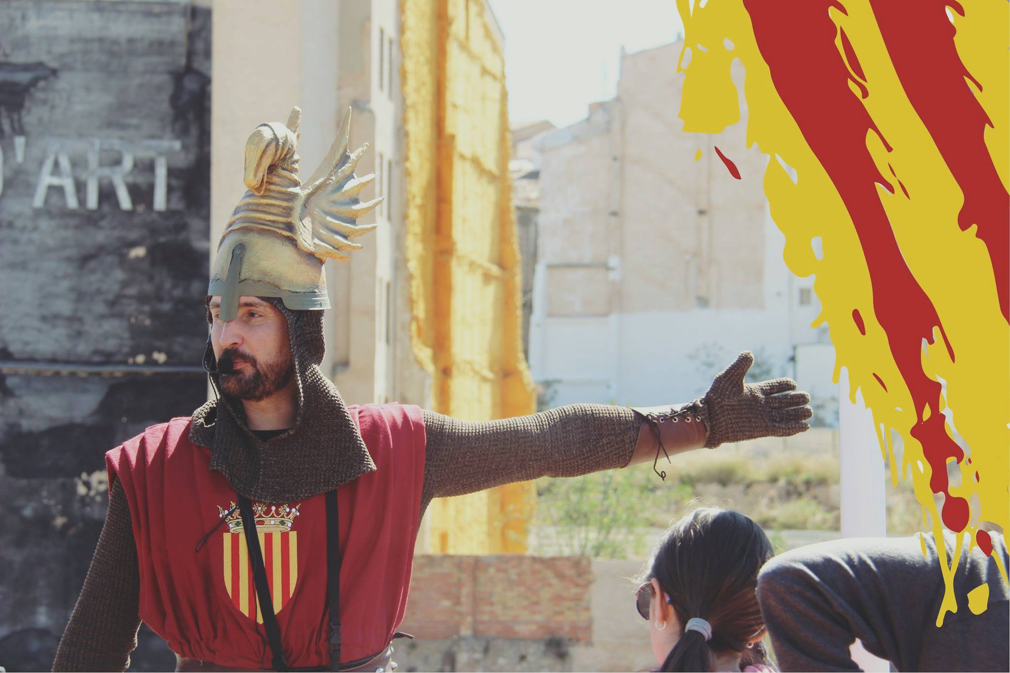 tourist guide disguised as a medieval while visiting Alcoy